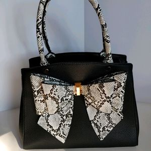 Leather purse with detailed bow